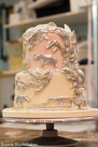 A beautiful Bonnie Brunt Cake with animal brass relief -perfect for a Riverbanks Zoo Wedding!