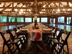 A Kings Table set up for a wedding or private event in the Ndoki Lodge at Riverbanks Zoo.